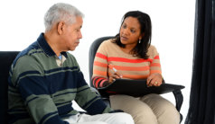 caregiver talking to a senior man