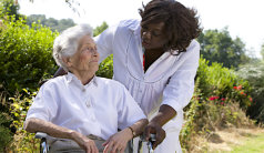 caregiver and senior woman out on a walk