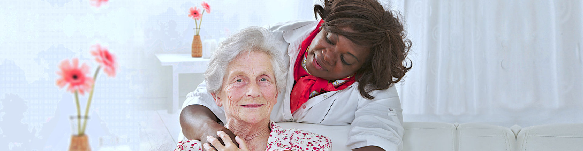 caregiver looking tenderly at her patient