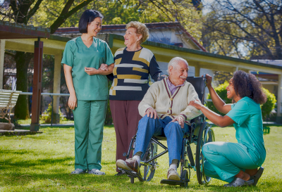 caregivers along with their patient enjoying the park