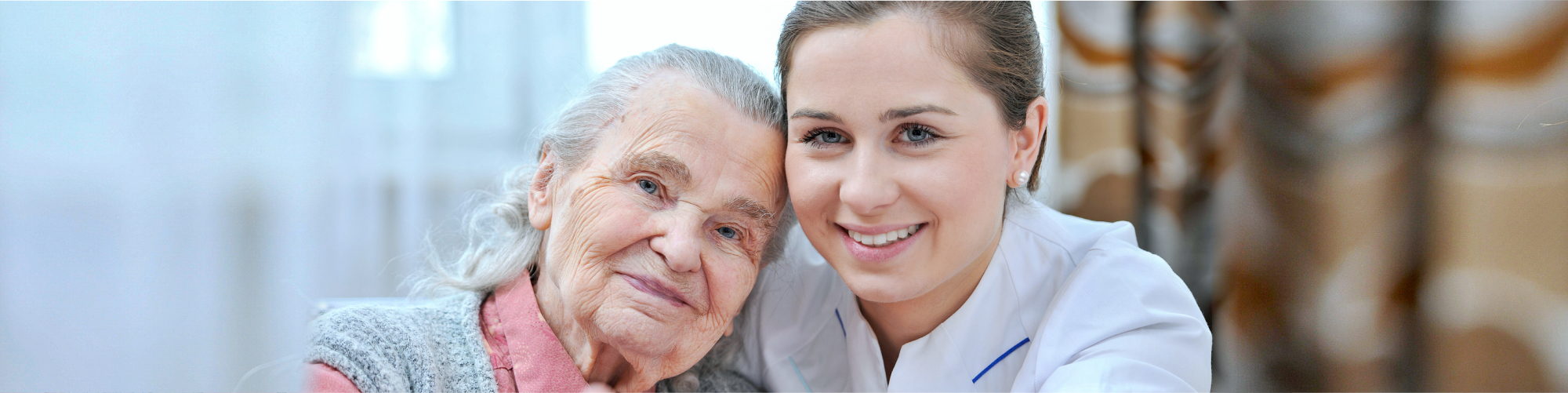 caregiver smiling along with her patient